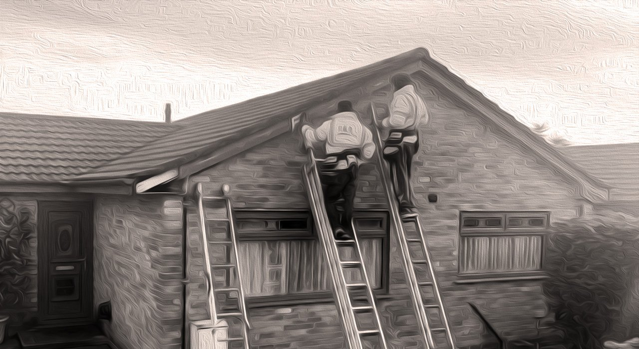 Two of our team hard at work installing Cedral cladding on a gable end bungalow
