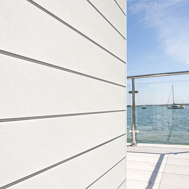 Cedral Click Cladding Wooden finish on a building by the sea