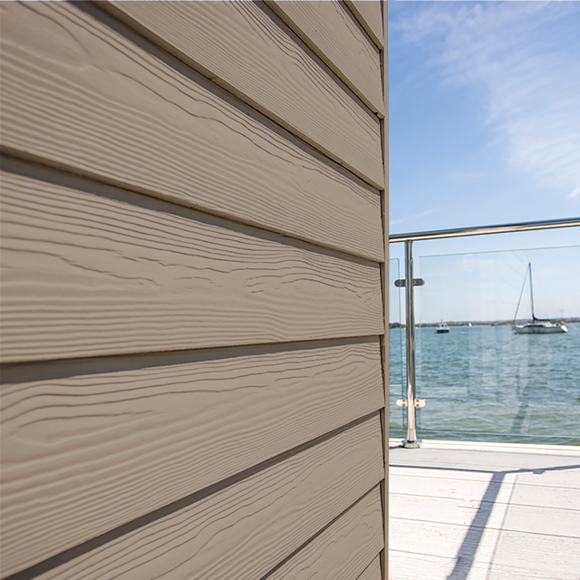 Cedral Lap Cladding Wooden finish on a building by the sea